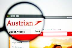 Air carrier Austrian website homepage. Austrian Air logo visible through a magnifying glass. Washington, USA - April 03, 2019: Air carrier Austrian website stock photography