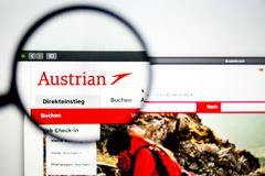 Air carrier Austrian website homepage. Austrian Air logo visible through a magnifying glass. Washington, USA - April 03, 2019: Air carrier Austrian website royalty free stock photography