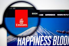 Air carrier Emirates website homepage. Emirates Air logo visible through a magnifying glass. Washington, USA - April 03, 2019: Air carrier Emirates website stock image