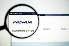 Air carrier FinnAir website homepage. FinnAir logo visible through a magnifying glass. royalty free stock images