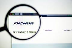 Air carrier FinnAir website homepage. FinnAir logo visible through a magnifying glass. Washington, USA - April 03, 2019: Air carrier FinnAir website homepage royalty free stock images