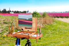 Washington, USA - April 16, 2010: Painting canvas outdoor. Fine art artist. Plein-air at tullip valley Stock Images