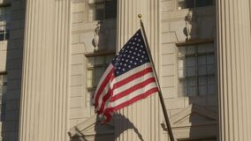 USA flag on facade of US Commerce building in Washington DC