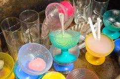 Washkopp, klart exponeringsglas och kopp Royaltyfria Foton
