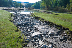 Washout Erosion. Tropical storm Irene dumped tons of water on Vermont causing massive flooding. This is the site of the annual Quechee hot air balloon festival royalty free stock photo