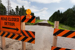 Washout: rain flood damaged badly washed out road Royalty Free Stock Photo