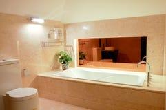 Washroom with big bathtub. And mirror Royalty Free Stock Image
