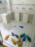 Washroom slip ons at ablution place for muslims for purification before prayer session at Kobe Mosque, Kobe, Japan royalty free stock image