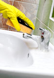 Washstand faucet cleaning Stock Photos