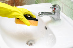 Washstand faucet cleaning Stock Image
