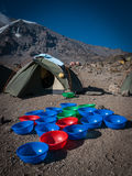 Washy washy time on Kilimanjaro. Washing bowls for trekkers at Karanga campsite on Kilimanjaro Machame route with glaciers of southern icefields on the rim of Royalty Free Stock Image