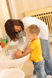 Wasing hands. Washing hands in preschool - teacher and 3-4 years old preschooler Royalty Free Stock Images