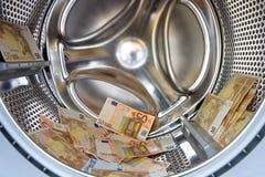 Wasmachine binnen met geld Royalty-vrije Stock Fotografie
