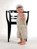 'it wasn`t me'. Little boy with a chair Stock Photos