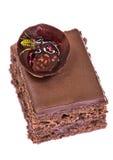 The wasp eats jam on cake. The wasp eats jam on chocolate cake on a white background royalty free stock photos