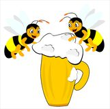 Wasps. Two bees flying around over a glass of beer Royalty Free Stock Image