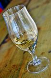 Wasps in the glass of white wine Royalty Free Stock Photography