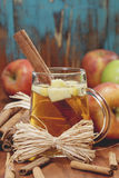Wassail Punch. Winter drink with apples and spices on rustic wood Stock Photos