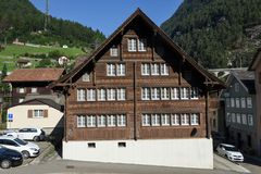Traditional chalet at Wassen on the Swiss alps. Wassen, Switzerland - 5 August 2017: traditional chalet at Wassen on the Swiss alps Royalty Free Stock Photos