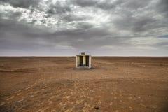 Wasser auf Wüste Stockbild