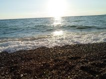 Wasser, Meer, Sonne, Sonnenaufgang, hell, hell, Strahl, Strand, Sand, schön, schön, Wellen, schaumig, Rest, Reise, Ozean, Abgrund stockfoto