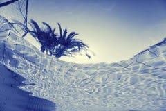 Wasser und Regenschirme Stockbilder
