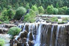 Wasserfall im Tal des blauen Mondes, Lijiang, China Stockfotos