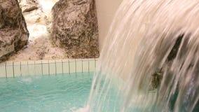 Wasserfall im thermischen Pool stock video footage
