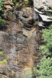 Wasserfall mit Regenbogen Lizenzfreie Stockfotos