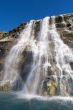 Wasserfall und Regenbogen Stockbilder