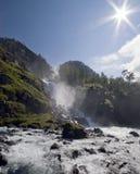Wasserfall und Sonne Stockbilder