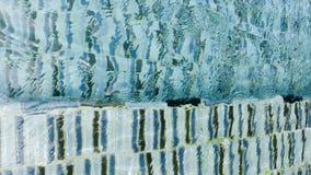 Wasserkräuselungsmuster im poo Stockfotos