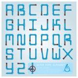 Wasserleitungs-Alphabet-Guss-Charakter Lizenzfreie Stockfotos