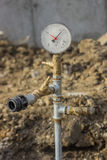 Wassermanometer für druckprüfendes der Wasserleitung stockbild