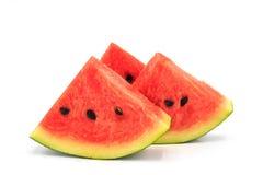 Wassermelone geschnitten auf weißem Hintergrund Lizenzfreie Stockfotografie