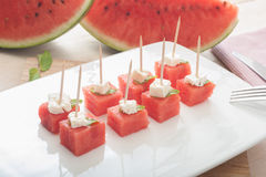 Wassermelone und Käse lizenzfreies stockfoto