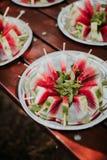 Wassermelonen-Scheiben-Eis am Stiel stockfoto