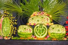 Wassermelonen-Schnitzen Stockfotos