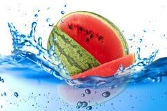 Wassermelonenspritzen stockbild