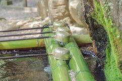 Wasserschöpflöffel am Reinigungspavillon Lizenzfreie Stockfotografie