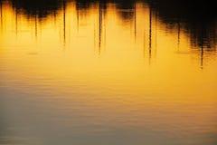 Wassersonnenuntergang Stockfoto