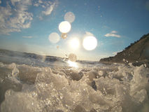 Wasserspritzen auf Meer Stockfotografie