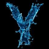 Wasserspritzen des Zeichens Y Stockfotos