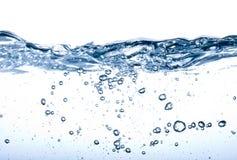Wasserspritzen getrennt auf Weiß Lizenzfreie Stockfotografie