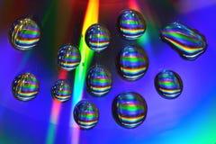 Wassertropfen auf CD Stockfotografie