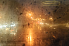 Wassertropfen auf dampfigem Glas Stockfotografie