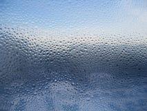 Wassertropfen auf Glas Stockfoto
