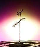 Wassertropfenzusammenstoß Stockbilder