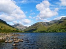 Wast Water Stones. Wide view of Wastwater Lake in Cumbria, UK. Shot down the lake with large rocks in the forground Royalty Free Stock Images