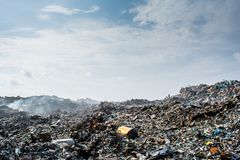 Wastage at the garbage dump full of smoke, litter, plastic bottles,rubbish and trash at tropical island. Wastage at the garbage dump full of smoke,litter Stock Photos